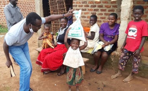 Delivering food parcels in Uganda